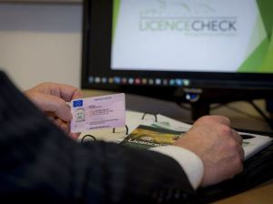 Man carrying out online licence check