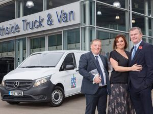 James and Rebecca Hall, of JMHC Logistics, with Mercedes-Benz Vans' Mike Parrott