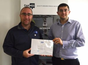 CoolKit staff members with Ford QVM certificate