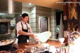 John making fresh roti