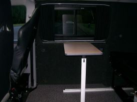 Interior view, Fold away table, Sports front seats, Fold down bed in the rear