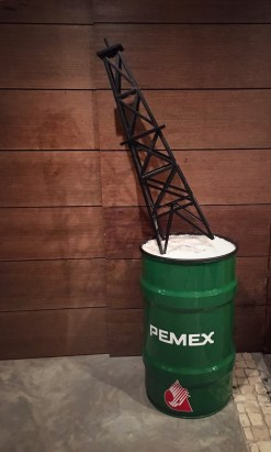 The model of the piece Cuahtémoc II, 2014, in which the logo for PEMEX, Mexico's national oil company, is turned upside down and fallen to the ground after the Mexican government opened up the oil industry to foreign investment and production.