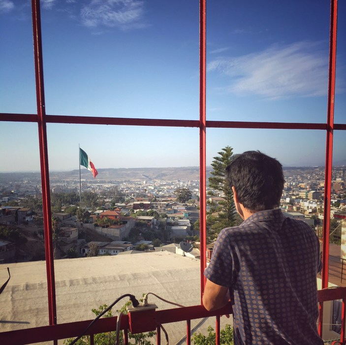 Shinpei Takeda looking out over Tijuana from his balcony. Photo by Chi Essary