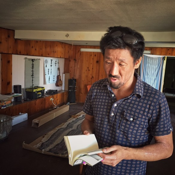 Takeda talks about the two Japanese published books about his work. Photo by Chi Essary
