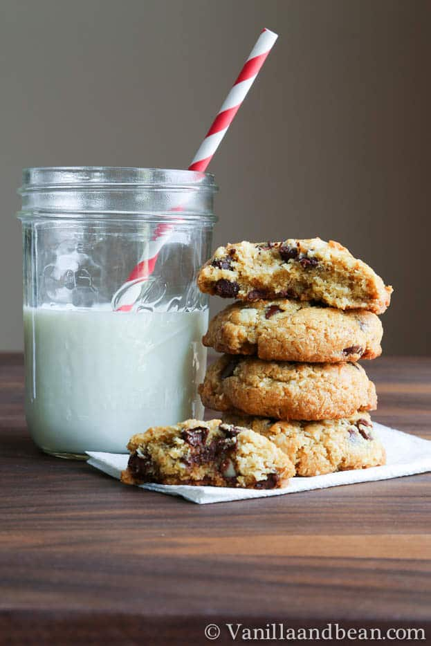 Coconut Macadamia Nut Chocolate Chip Cookies with a jar of milk and a straw