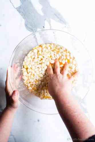 Removing flesh from pumpkin seeds