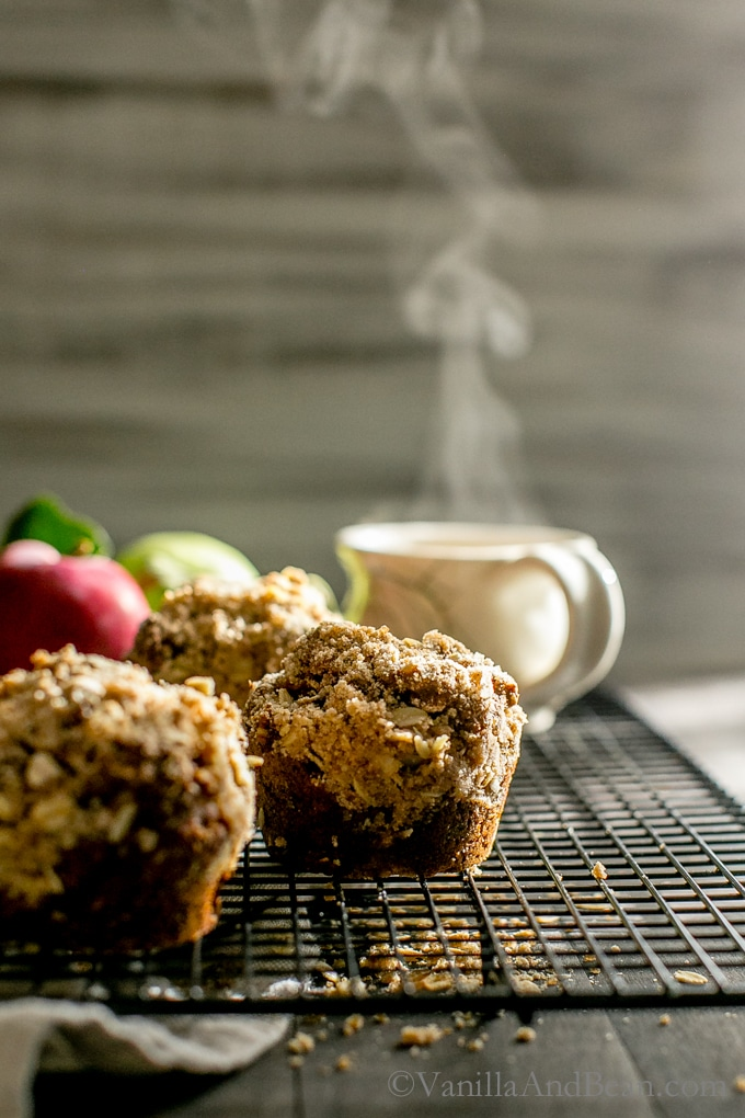 Warming and cozy Vegan Apple Gingerbread-Oat Walnut Muffins with Brown Sugar Streusel are easy to make and freezer friendly! Welcome fall!