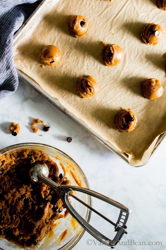 Scooping the Flourless Peanut Butter Chocolate Chip Cookies from Kathryne Taylor's new cookbookLove Real Food have a whole jar of peanut butter in there! Tender, rich and oh SO peanut-buttery! Gluten-Free | Grain Free | Recipe | Cookies |