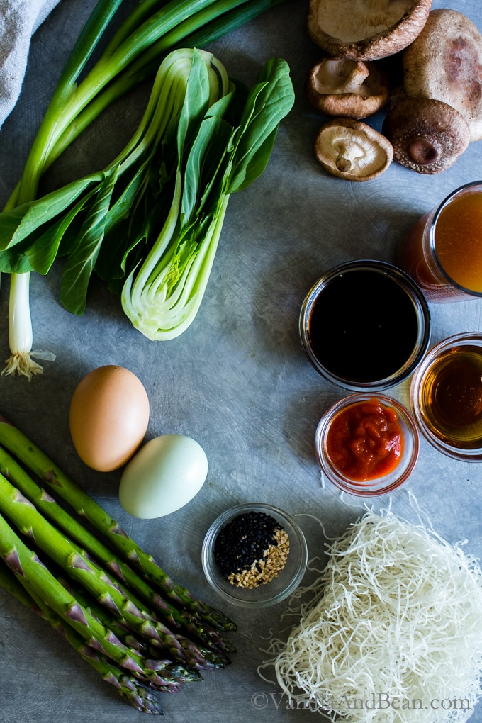 A quick and easy dinner with bold flavors, seasonal spring ingredients and a little crunch swimming in a umami-filled sauce; Garlicky Asparagus, Mushroom and Bok Choy Noodle Bowls. Vegetarian or Vegan + Gluten Free