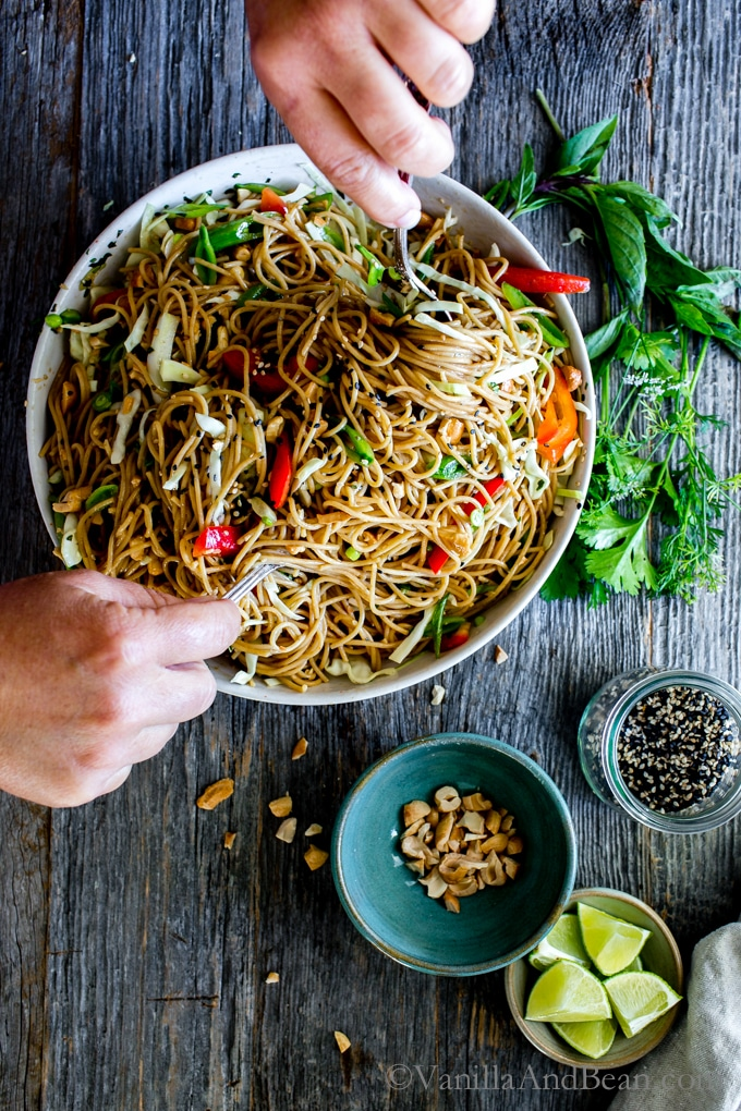 A flavor packed dressing with crunchy veggies, Sesame-Ginger Noodle Salad with Cashews comes together with ease. Make once, eat all week! Vegan + Vegetarian + Optionally Gluten Free | Vegetarian | Dinner | Lunch | Meal Prep