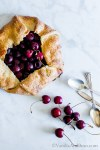 A hint of lemon, almond and brown sugar bring out the season's best in this rustic Sweet Cherry Galette. Vegan or Vegetarian