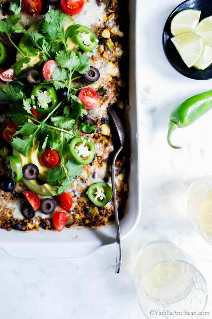 Quinoa Enchilada Bake with Black Beans is a fabulous casserole to feed a small crowd. It's freezer friendly and makes for easy leftovers. #vegetarian #glutenfree #MexicanFood #Casserole #QuinoaBake