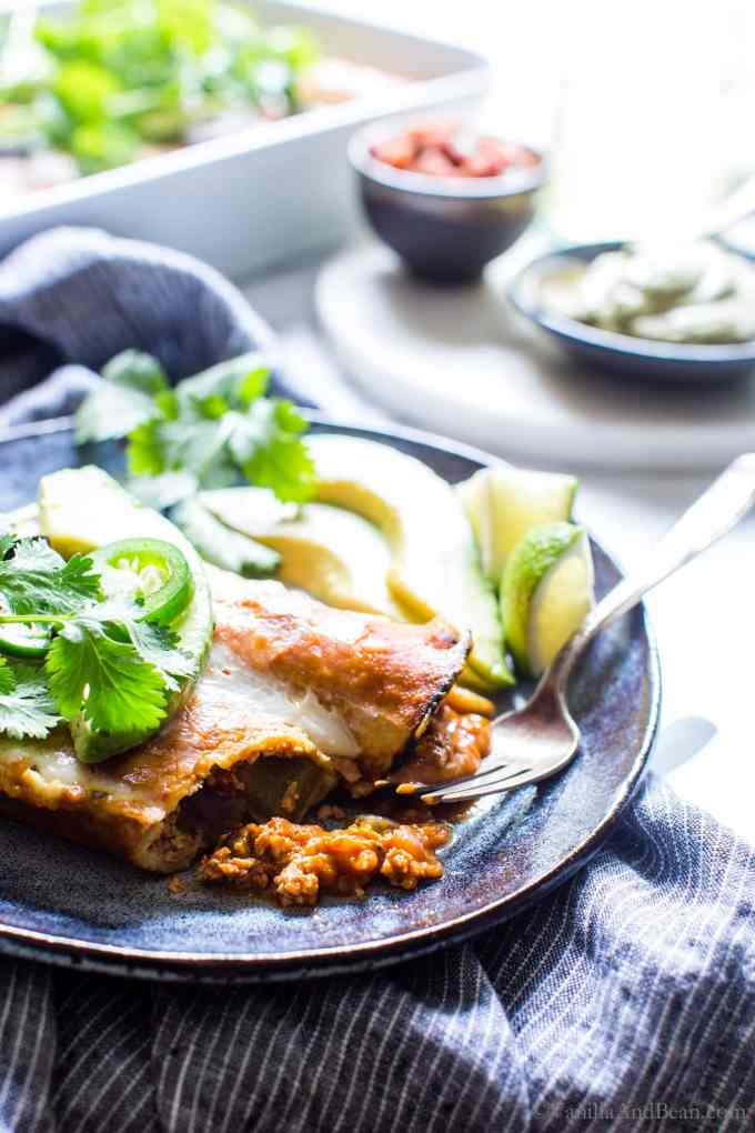 Vegetarian Enchiladas are flavor packed, texture rich and so easy to make! They're freezer friendly and easily gluten free too! #VegetarianEnchiladas #MexicanTofu #Enchiladas #TofuEnchiladas #MeatlessMonday
