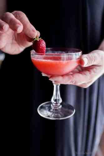 Hands holding Frozen Wine Slushies in Aperitif Glass