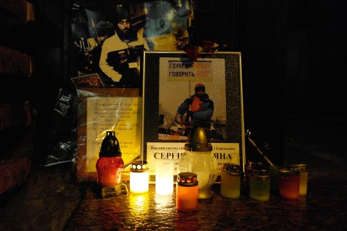 Images and candles at the entrance of the Armenian church commemorate a young man of Armenian origion who was recently killed by the riot police in Kyiv.