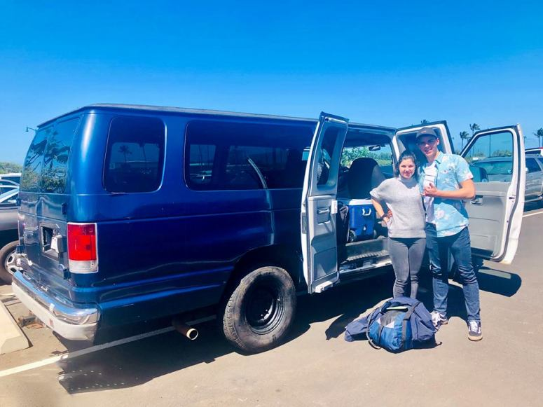 german couple adventure maui campervan rentals vanlife maui airport kahului drop off and pick up in royal blue maui campervan rental vanlife maui