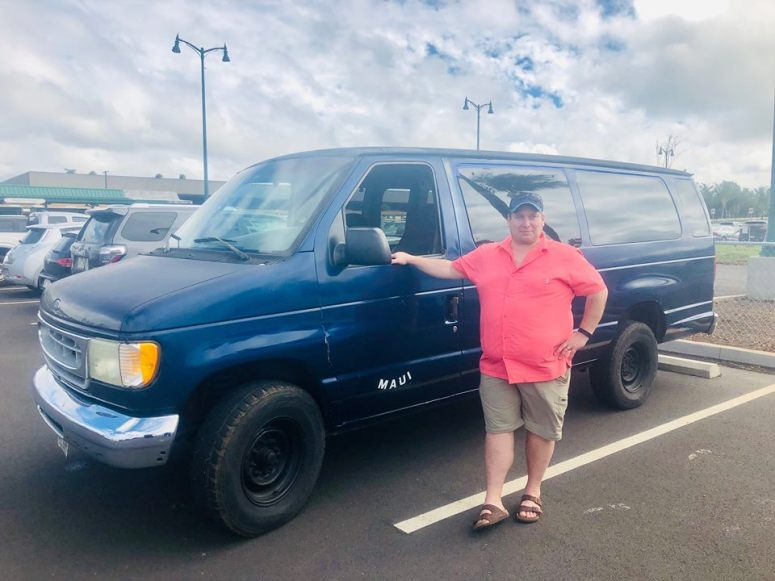 guest from Montana in royal blue maui campervan rental vanlife maui airport drop off delivery service