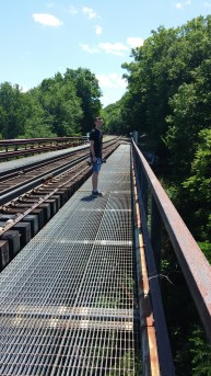 Adventuring with Brendan on a train trestle.