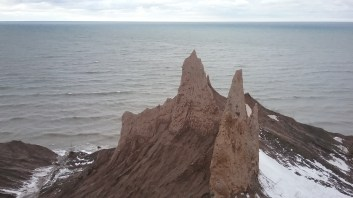 The chimney bluffs for which the park are named jut up at the waters edge like teeth. FAITH MECKLEY