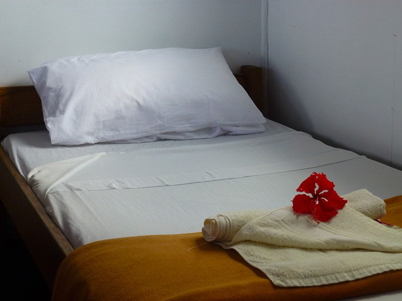 A view of a Single bed in Muma's Nima (Bungalow) at Tanna-Adventures in Middlebush.
