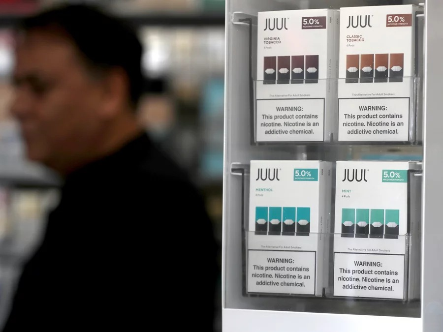Packages of Juul mint-flavored electronic cigarettes are displayed at San Rafael Smoke Shop in 2019 in San Rafael, Calif. Justin Sullivan/Getty Images