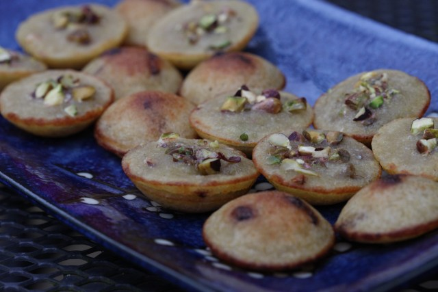 Appe with caramelised raisins and pistachios