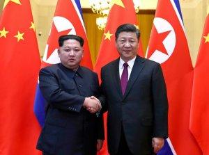 Kim Jong-un og Xi Jinping.