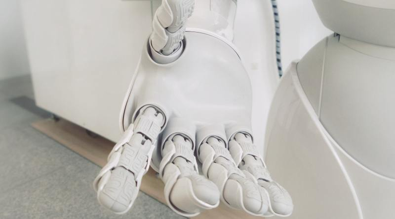 robot hand typing artificial intelligence