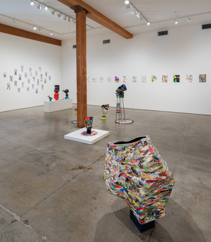 installation view of Claire Cowie's exhibition, In the Vacuum, Outside the Atmosphere, which includes groupings of paintings, collage, textiles and multilayered paper sculptures.