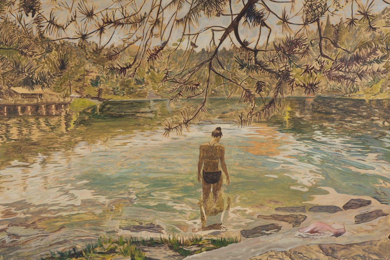 A impressionist painting of a woman walking into a lake. Her face is angled down to look at the water. The whole scene is warm hued, and the surrounding nature reflects in the lake's surface.