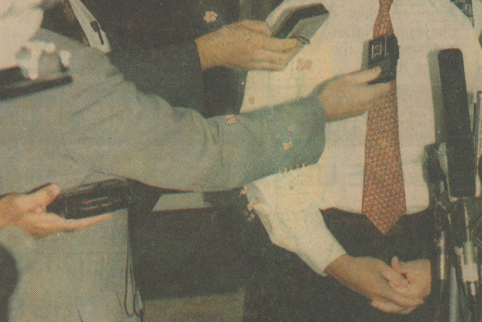 A screenshot of Untitled (Saturday, October 16, 1993) shows a weathered newspaper clipping of a figure dressed in a white shirt with red tie standing before microphones. Arms reach out from the left side of the shot with tape recorders and additional microphones preparing to record the speaker's voice.
