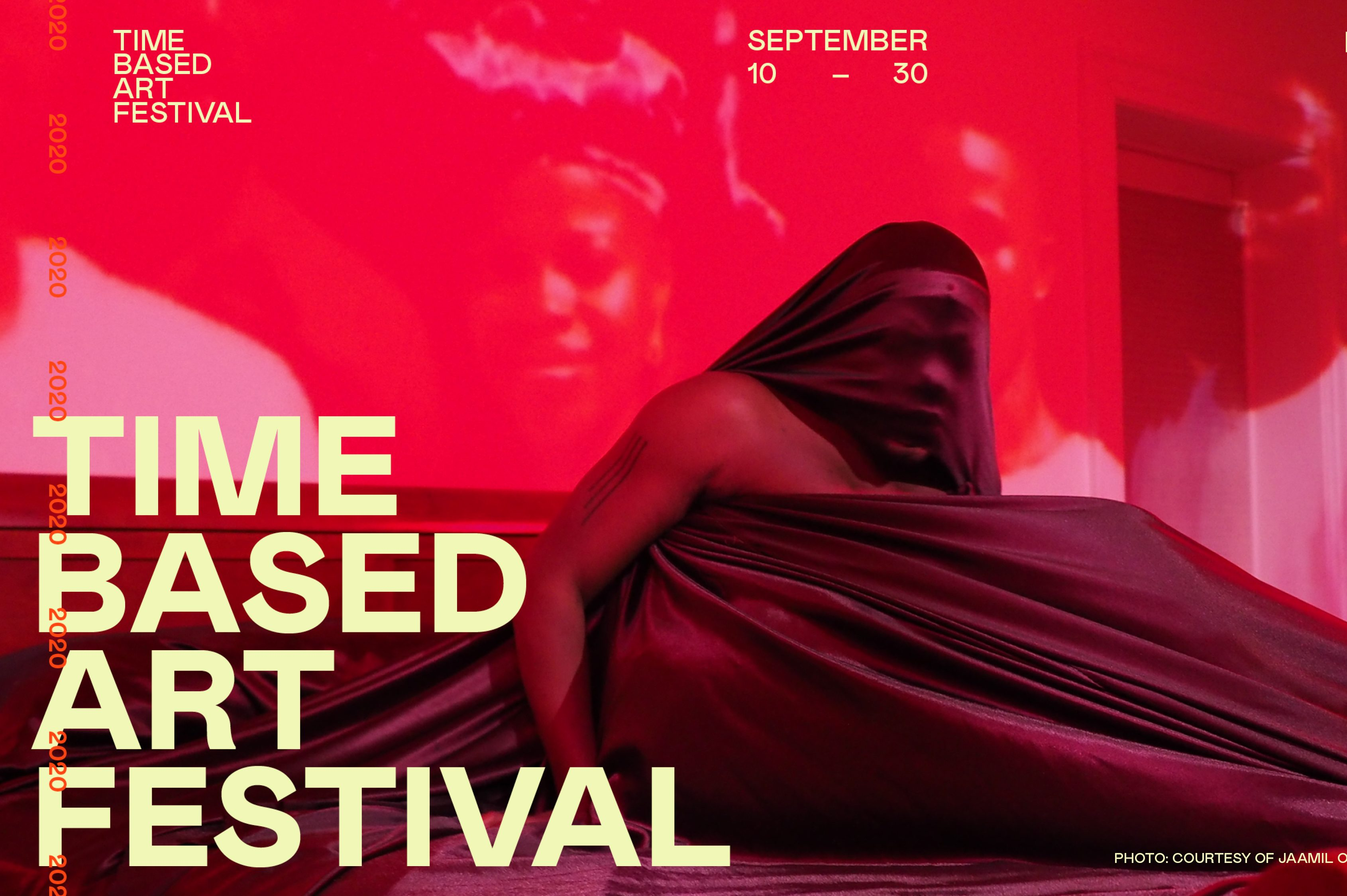 An exhibition flyer for PICA's Time-Based Art Festival. The background image is saturated with red, a person draped in fabric reclines, with fabric stretched over their face.