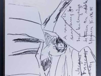 """A photograph of a square format spiral bound sketchbook with a sketchy drawing in black graphite. The drawing depicts a person bent over and walking through a crowded space. Perpendicular to the drawing horizon, cursive handwritten text reads: """"A man in searching for his belongings between the..."""" followed by two illegible words. In the bottom right corner, the artist wrote """"Jacques Francois Leroy"""" and crossed the words out."""
