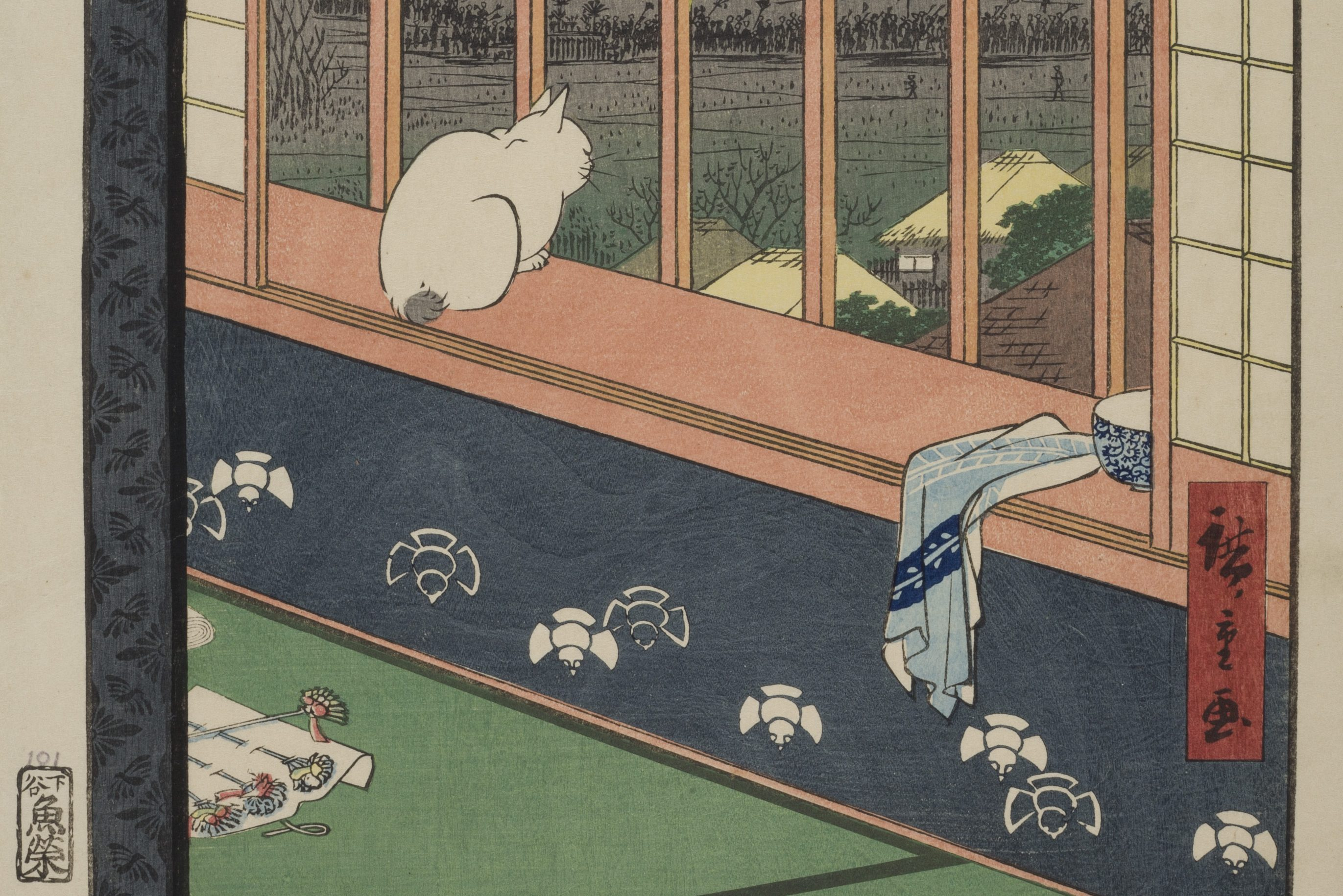 A section of an ink and color painting depicts a cat, seated on a windowsill, overlooking rice fields, as well as a small grouping of tan-roofed houses. A blue towel is draped over the edge of the windowsill, beside a blue bowl. Flowers attached in a row to a piece of parchment on the ground is partly out of frame.
