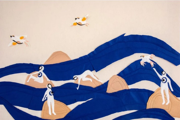 An image made in overlapping pieces of soft felt depicts large blue ocean waves with tan rocks jutting out of them. Most islands have a humanoid figure lounging or standing on it, the figures are entirely white, featureless, with a mati on their chest