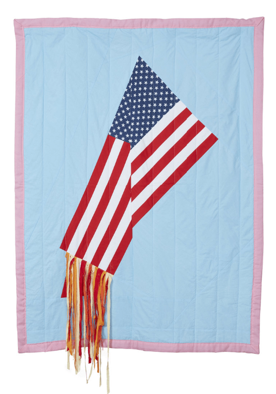 A United States flag, stitched onto blue fabric, is folded on itself and spewing streams of subtle orange strips of fabric, as on fire, but nowhere near engulfed.