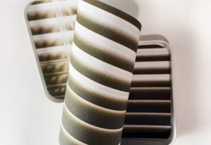An image of shaded blinds is curled into a tight spiral, warping reality into a near, contained shape.