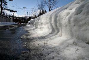 Pile of snow next to a road at Kusatsu Onsen, Japan