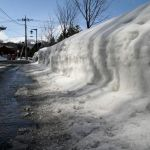 Pile of snow next to a road at Kusatsu Onsen, Japan