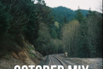 october cover art photograph tress train tracks