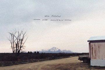 will johnson wire mountain album cover photo of desolate field and barn