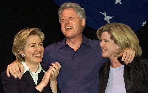 Whitney Gilmore does indeed appear on many official pictures of Bill Clinton, like this one of an Independence Day party on July 4, 2000 where she appears with the President and his wife Hillary.