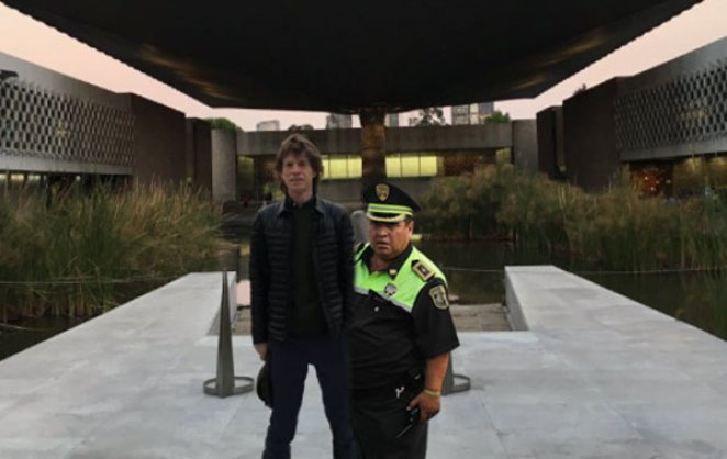 Museum guard is not allowing Mick Jagger to leave the museum until convince he is not a museum piece trying to escape.