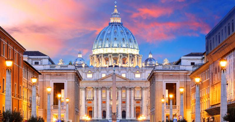 An evening shot of the St Peter's Basilica at the Vatican with its lights on