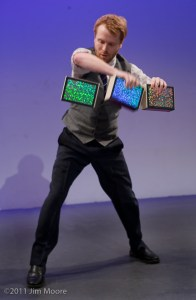 Kyle Petersen performs his Cigar Box juggling act at Bindlestiff Open Stage.