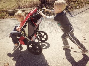 Bud pushing stroller