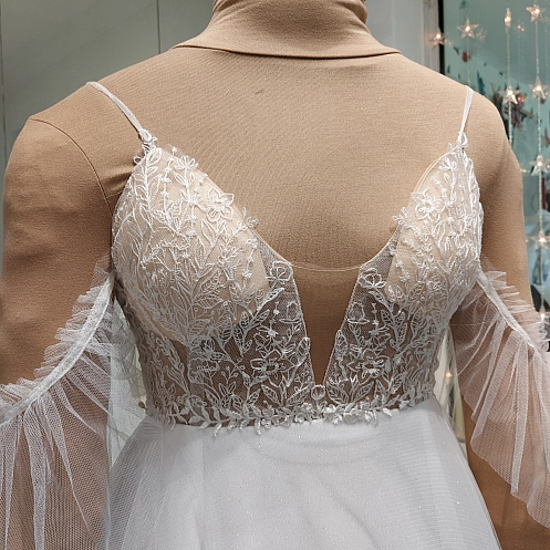Bespoke lace featuring wild flowers on custom wedding dress by Holly Winter Couture