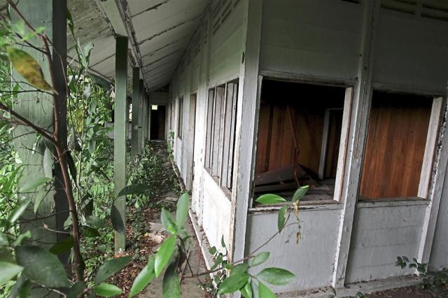 Overtaken by wild vegetation, the former Kuala Selangor Rest House is in terrible condition with many of its metal and aluminium fittings stripped away.