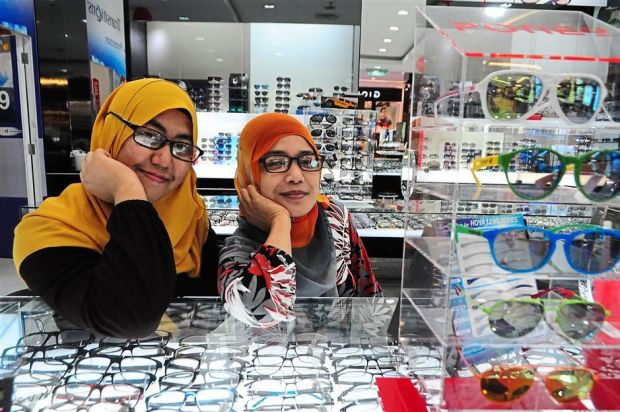 Nor Atiqah (left) and Murni Azzirawaty, whose office is located in the mall, use their lunch break to shop at the mall.