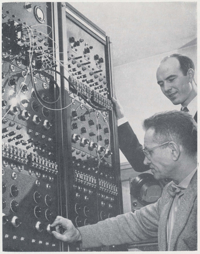 Dr. Warfield (upper right) and a colleague work on an early computer in the 1950's. (Source: The Pennsylvania State Engineering Review, Summer 1954)